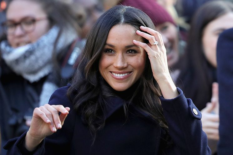 Meghan shows what a stunner she is as well as the beautiful ring!