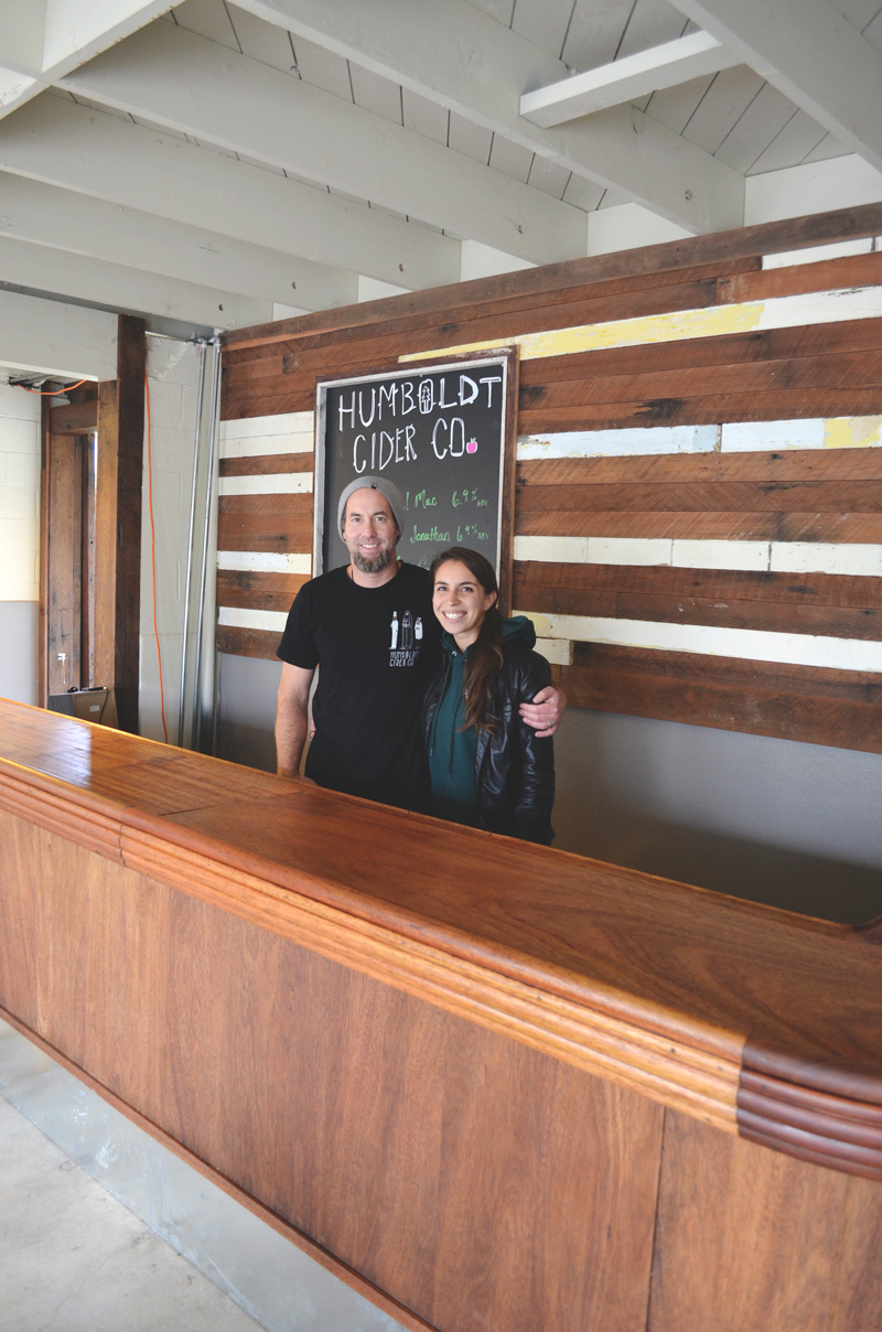 Darren and Michelle behind their beautiful reclaimed bar.