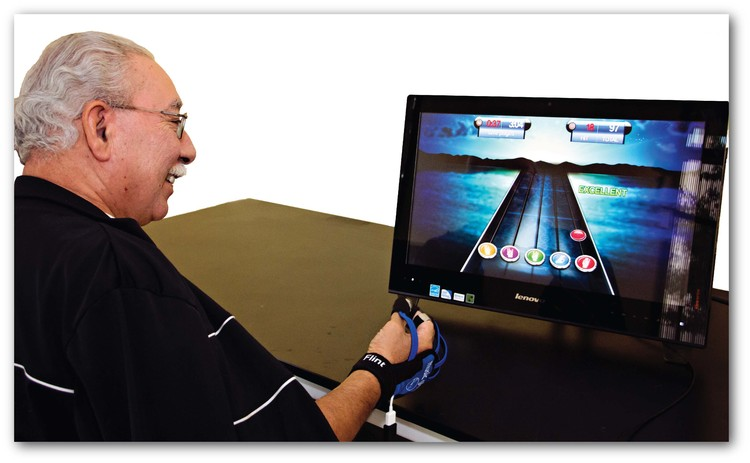 A man playing on teh clinical version of MusicGlove