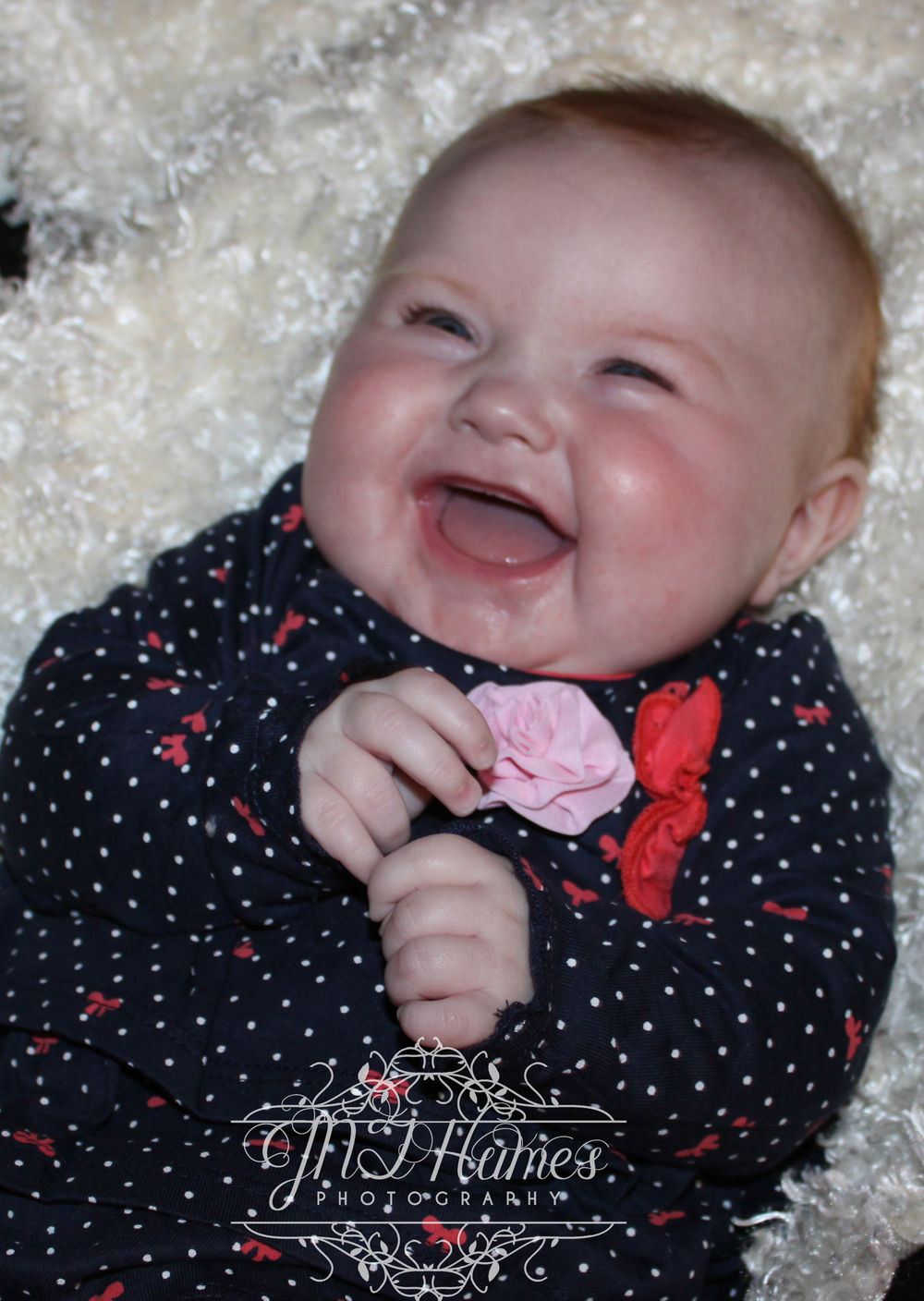 Lilly giggling like only a 4 month old can....