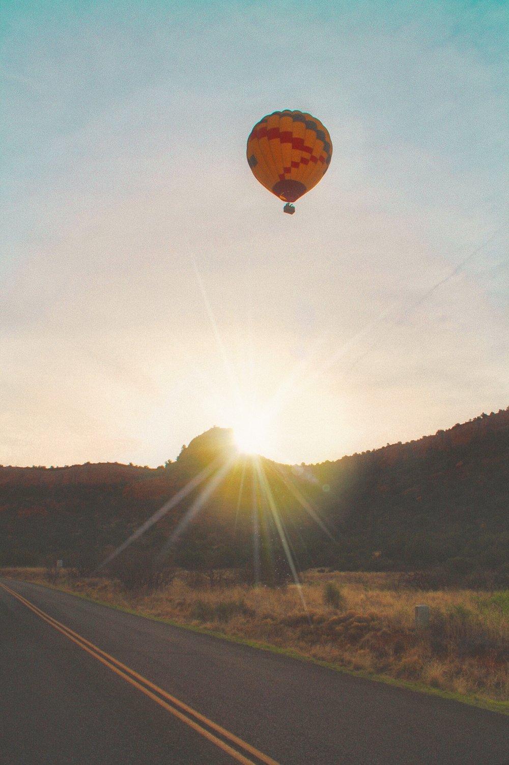 balloon at sunrise over sedona