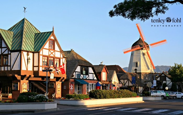 """How A Wine Country Photographer Caught National Geographic's Attention"" - Jetset Times article by Lena Kazer.  Tenley Fohl's windmill street scene photo inside National Geographic's book ""Abroad at Home"" on the section featuring Solvang, CA."