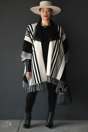 Forever 21 Grated Stripe Sweater  Poncho , H&M Bodysuit ( similar ), BCBG MaxAzria Leather Jacket, Zara  Leggings , BCBG MaxAzria Bari Exotic  Booties , Henri Bendel Bag ( similar ), Brixton Buckley  Hat