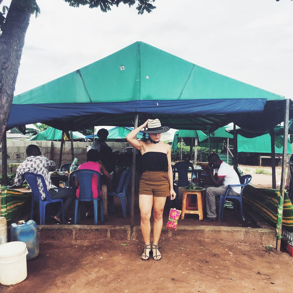 A Mom & Pop's restaurant on the road side in Owerri. Halogen Hat, Zara Shorts, Sam Edeleman Sandals