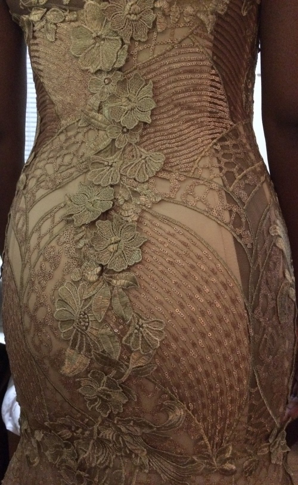 Back view of lace applique, boned, trumpet silhouette, wedding gown