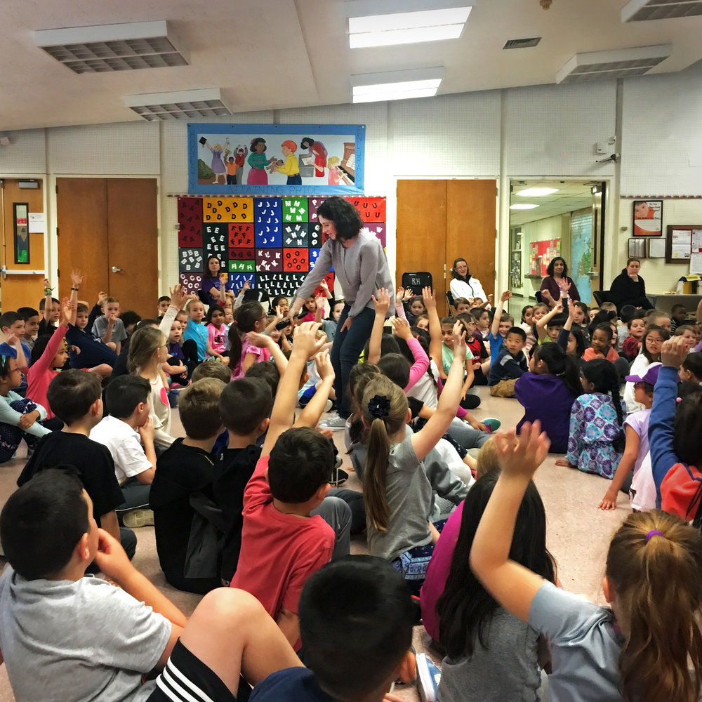 Working the K through 2 crowd with the mic at Rolling Hills Primary!  |  Photo courtesy of Jen Ryan