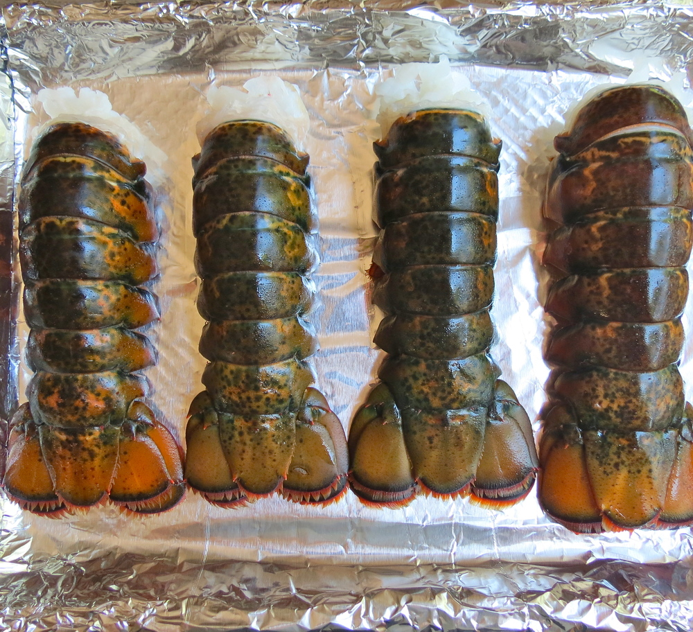 Lobster tails on baking sheet.