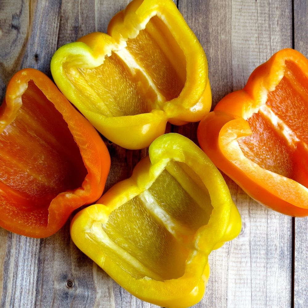 Peppers sliced in half- stem, pith, and seeds removed.