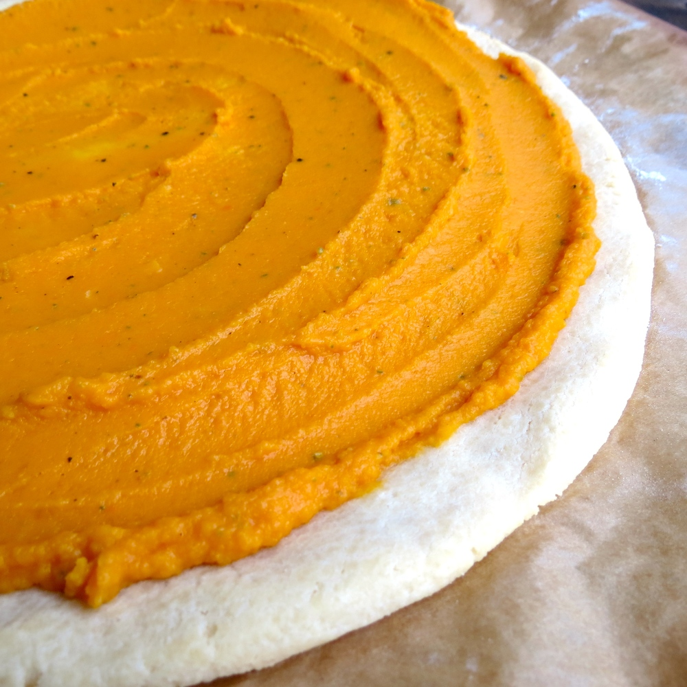 Butternut Sauce spread on baked pizza crust.