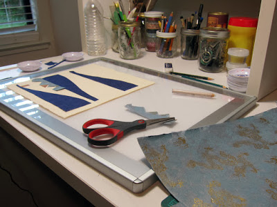 Photo of an ongoing collage on an artist's studio