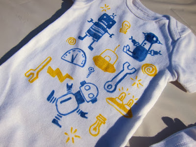 Robot onesie in blue and yellow by Diana Toledano