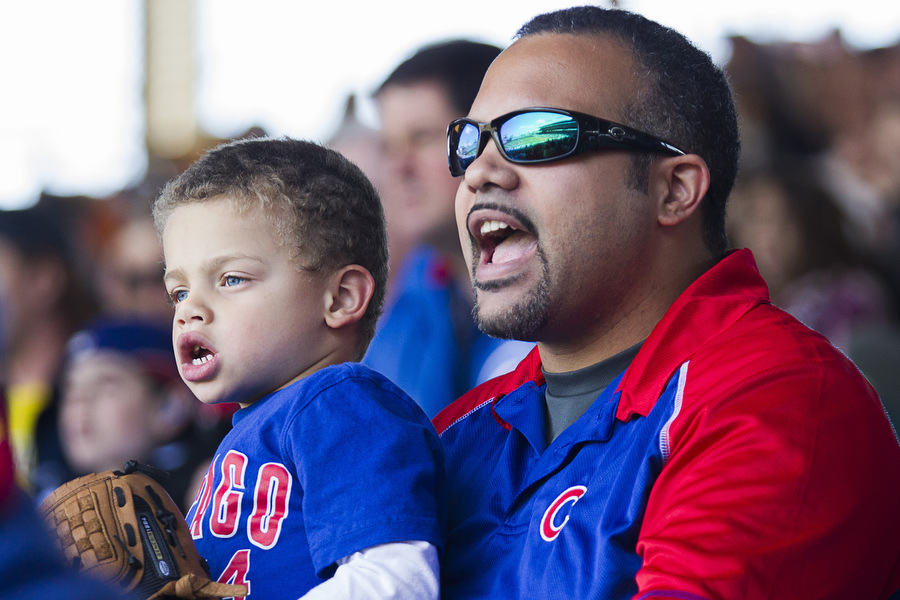 Jason Davis and his son Kalen, 5, take in the game.