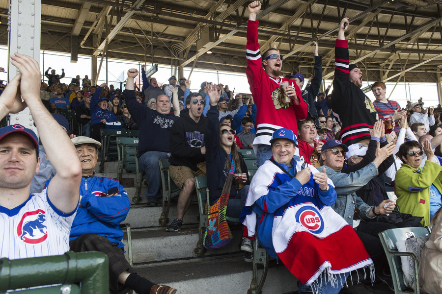 Fans cheer as Mike Olt hits a home run.