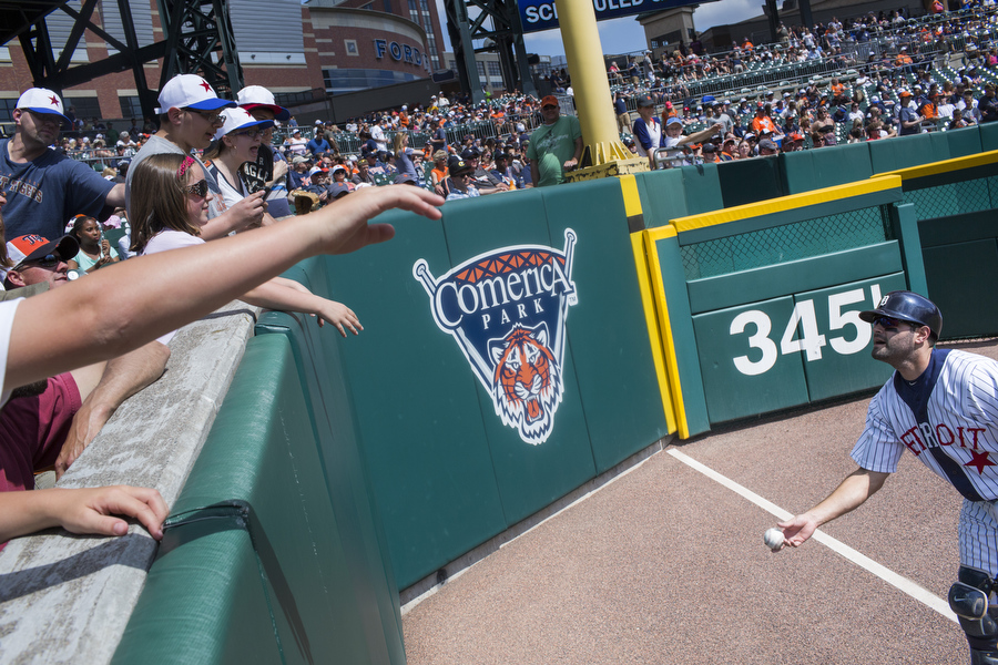 Alex Avila throws a ball to Kylie Atkins, 9, of Webberville, MI.