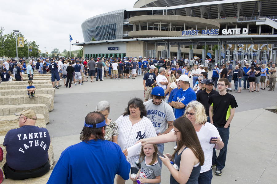 Fans wait to get into the game at Gate D.
