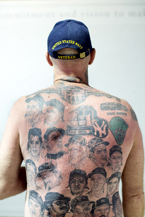Claude Godfrey attended his first Yankees game in 1970 and served in the Navy from 1976 to 1980. He has Yankees tattoos all over his body including faces of hall-of-famers on his back.