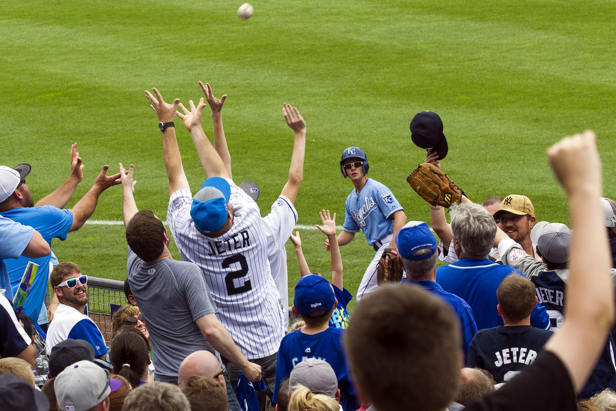 Derek Jeter (not pictured) throws a ball into the crowd at the end of an inning.