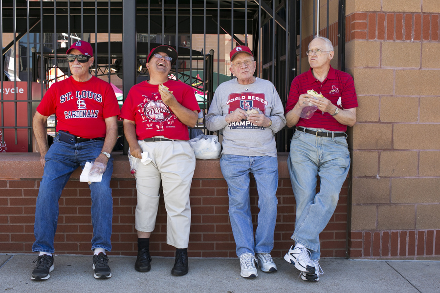 From left, Gene, Richard, Wes and Dick of the Manchester United Methodist Church choir eat homemade sandwiches outside the stadium before assembling to sing the National Anthem on Saturday night.