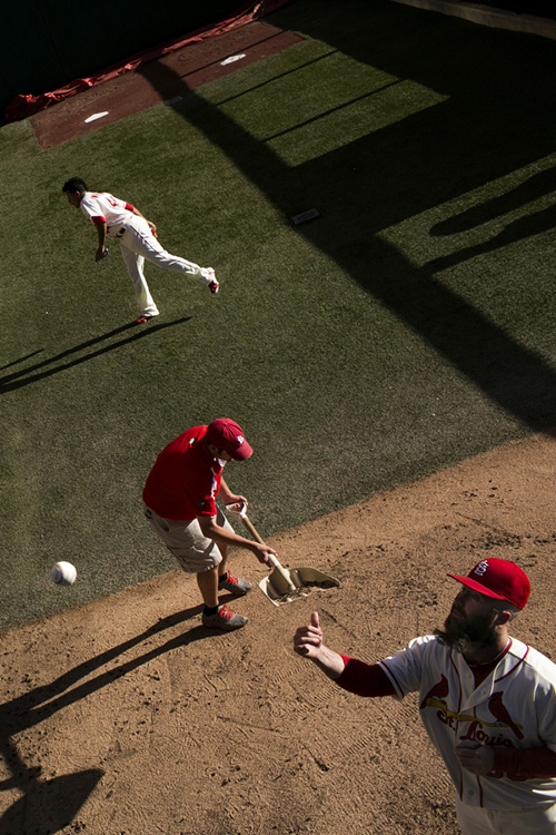 Reliever Jason Motte tosses a ball to a fan.