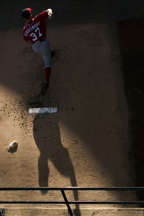 Stephen Strasburg warms up.