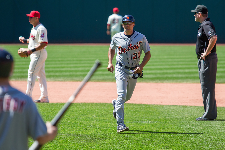 Tigers First Base coach Omar Vizquel walks off the field he called home for 11 seasons as a player. The day before this game, he was inducted into the Indians Hall of Fame.