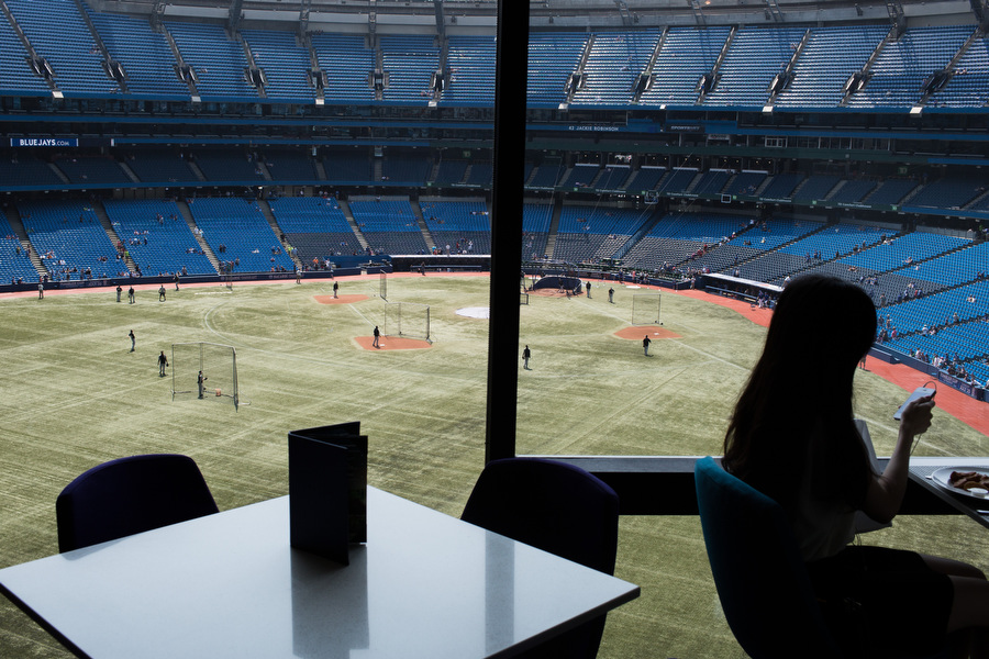 While the White Sox took batting practice, a woman checked her phone while eating breakfast at the Renaissance Hotel inside of the Rogers Centre.