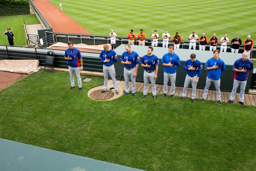 Those in both bullpens stand for the National Anthem.