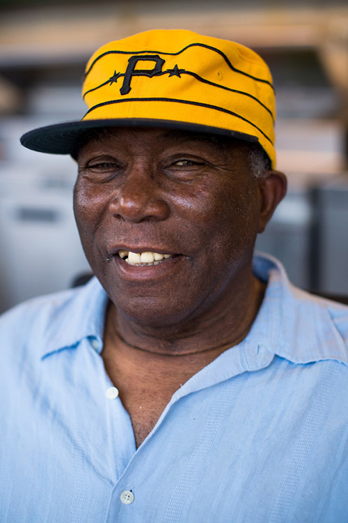Former Pirates catcher and three-time All-Star Manny Sanguillen owns a barbecue stand in left field. He signs autographs and poses for pictures with fans during the games.