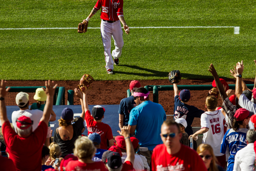Nationals first baseman Adam LaRoche throws a ball into the stands.