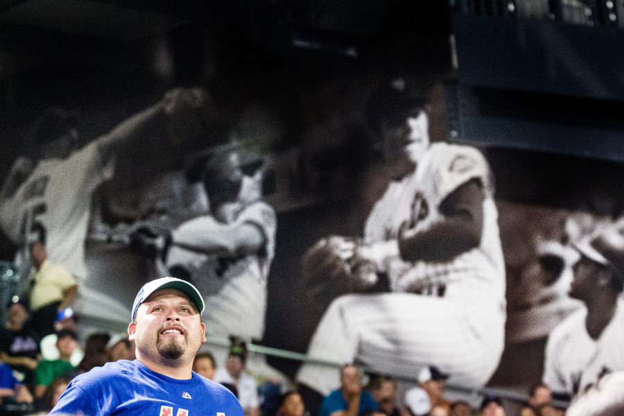 Some of the walls at Citi Field have photo collages of former Mets players on them.