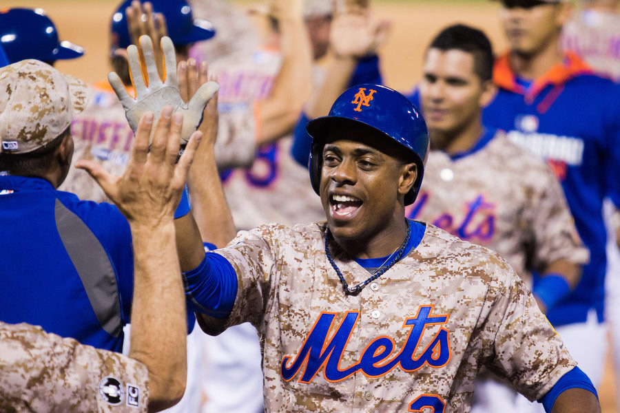 Mets outfielder Curtis Granderson who tied the game in the eighth inning with a solo home run high fives with teammates after the win.