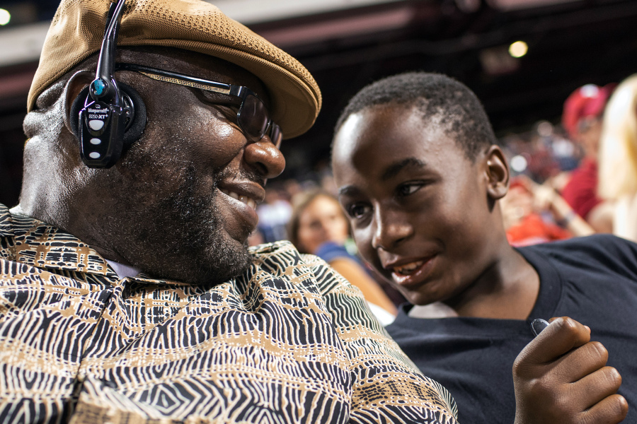 "Wayne, a 23-year Marine veteran, attended his second ball game ever and his nephew Dashon attended his first. ""It's the only place that you can act like a kid and nobody will care,"" Wayne said."