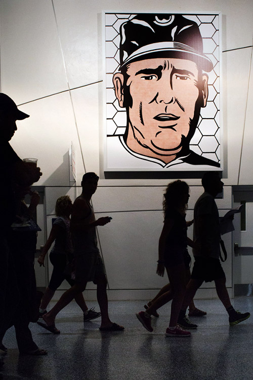 "A reproduction of Roy Lichtenstein's ""The Manager"" from 1963 hangs in the stadium. Marlins owner Loria is a modern art dealer and the stadiums has several modern art pieces displayed around the stadium."