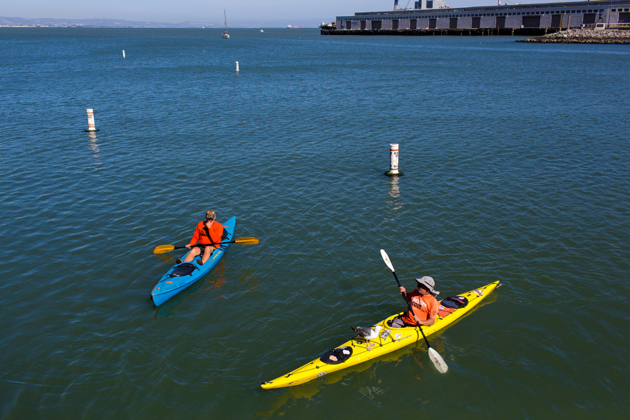 McCovey Cove Dave, left, has corralled 22 of the home runs hit into McCovey Cove. He's paddled out to almost all home games since 2005. Another home run-seeking kayaker on his right brings bread for seagulls and they sit on his kayak.