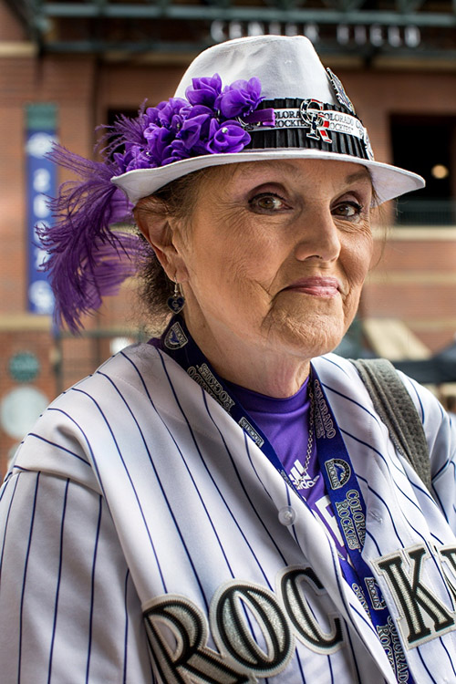 Sue O'Brien, 64, has attended Rockies games for 20 years. She made the hat she's wearing by herself.