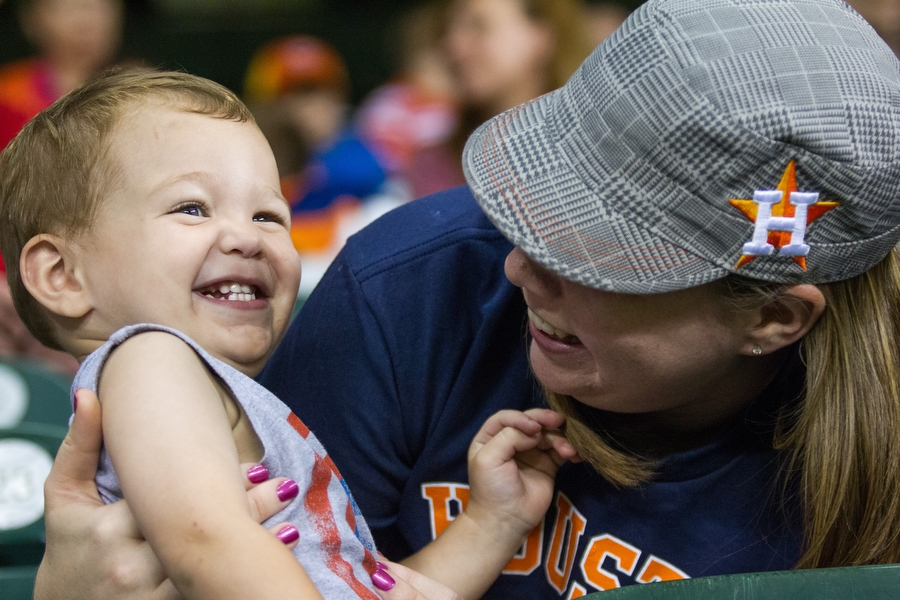 "Samantha and Cooper, 2, share a laugh after singing ""Deep In the Heart of Texas."""
