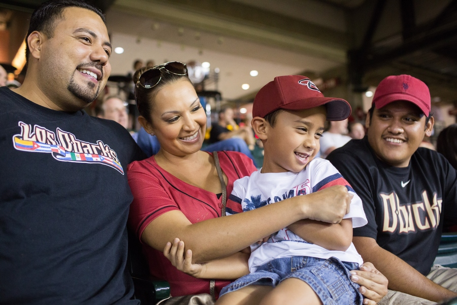 From left, Frank, Adrienne, their son Aiden and his cousin Favian share a light moment during the game.