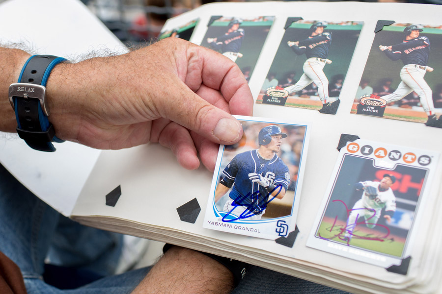 Mike Bowman is a hobbyist card collector. He arrives early to most games with a book full of cards of former and current Padres players and coaches. The majority of the cards he gets signed will never have much value but he said he enjoys collecting the cards and often gives cards and balls away to fans.