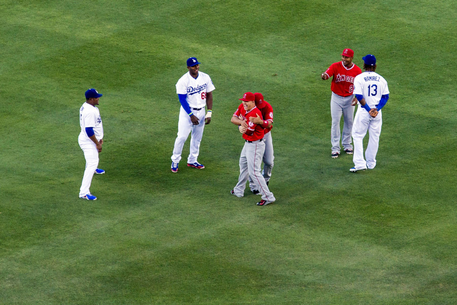 Los Angeles Dodgers and Angels players converse before the game.