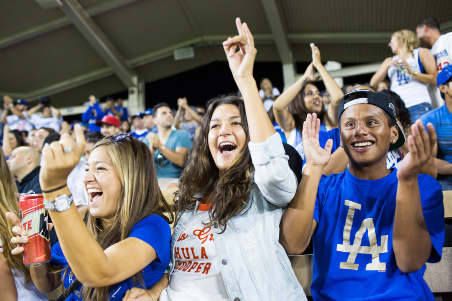 Michael, right, his sister Lacy, center, and her co-worker Kaytee react after the Dodgers kept the Angels from scoring.