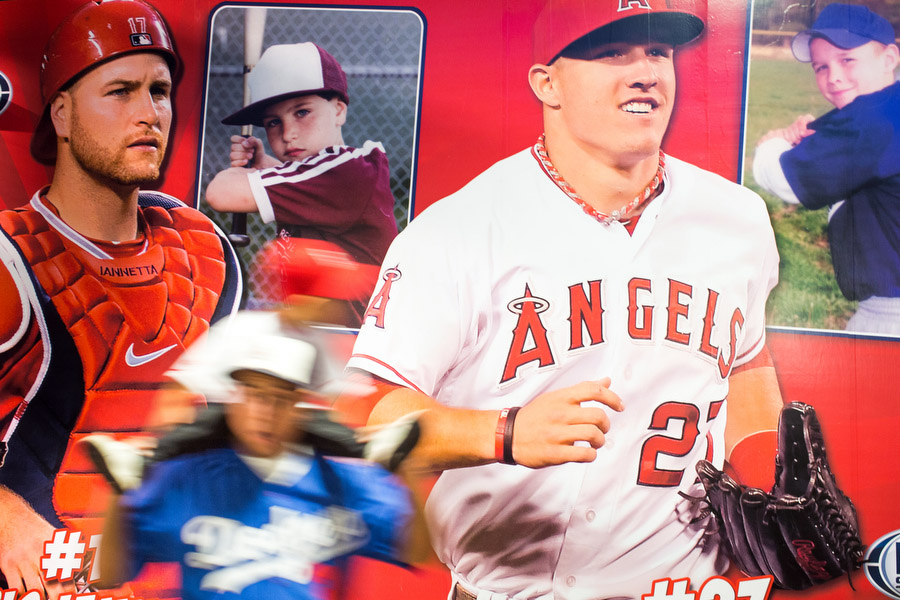 One the wall is a poster with photos of when current Angels Mike Trout and Chris Iannetta played in little league.