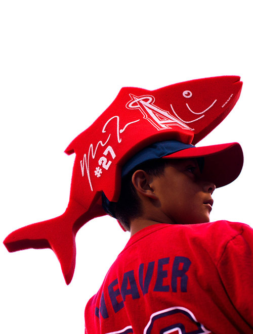 A fan wears a foam hat attachment in the shape a trout, a show of support for Angels outfielder Mike Trout.