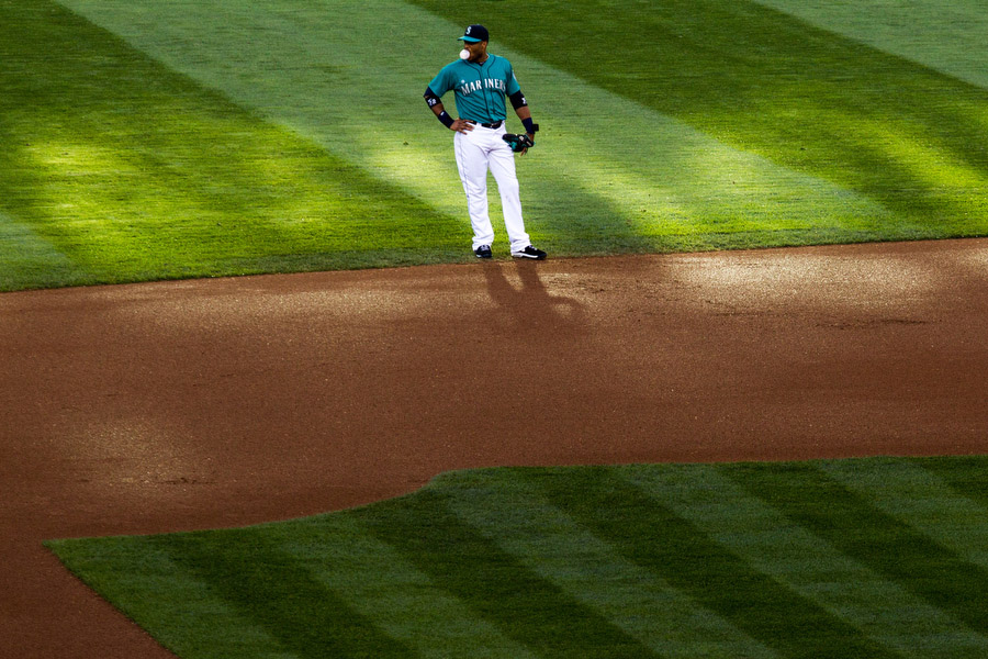 Mariners second baseman Robinson Cano blows a bubble during the game.
