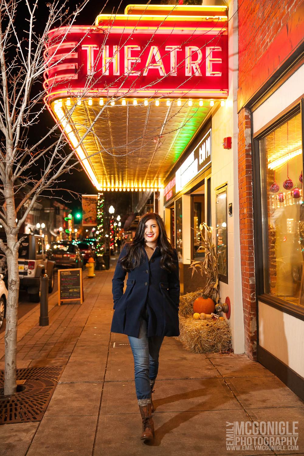 Girl walking on sidewalk at Franklin Theatre