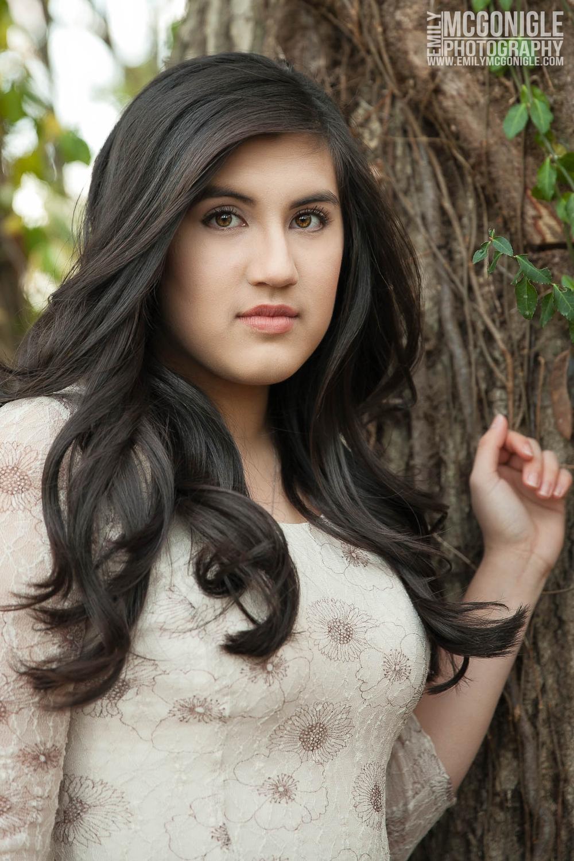 Headshot brown hair girl with a tree