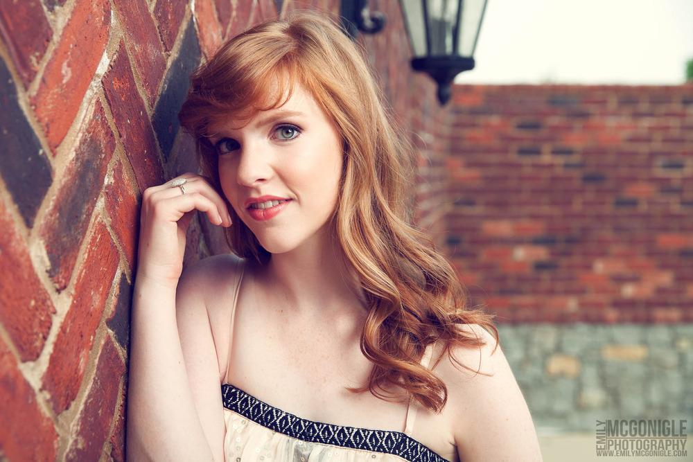 girl-portrait-red-hair-brick.jpg