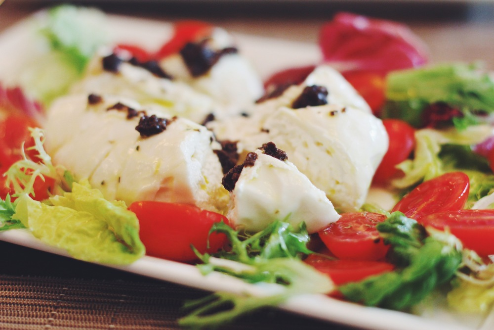 Caprese di Bufala Fresh sliced tomato with Whole buffalo Mozzarella Cheese Dressed with Extra Virgin Olive Oil