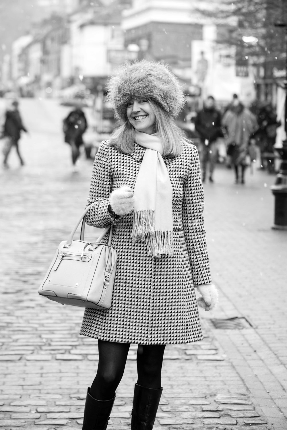 Woman in furry hat and checked coat.jpg