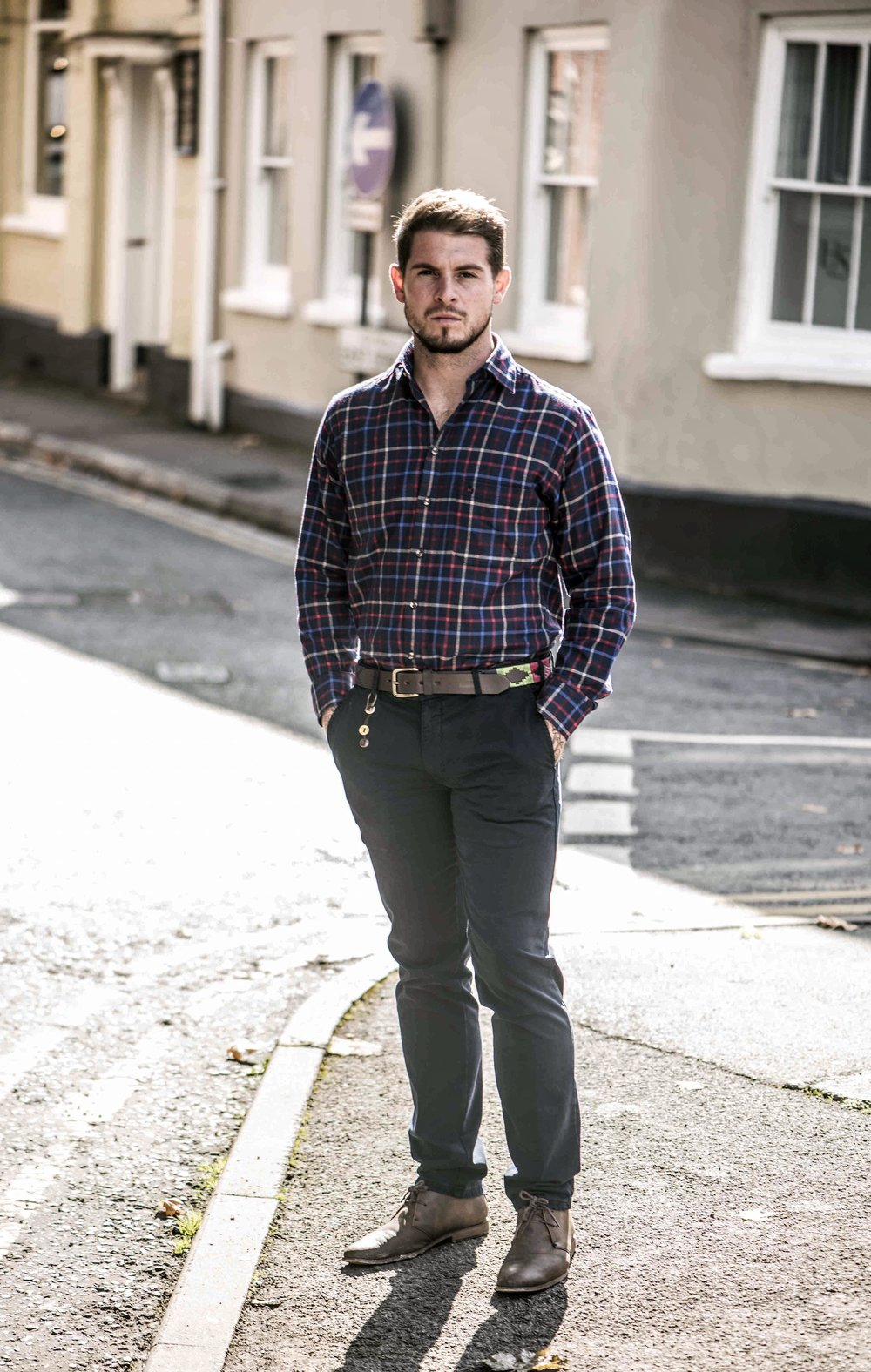 Man in check shirt and blue trousers.jpg