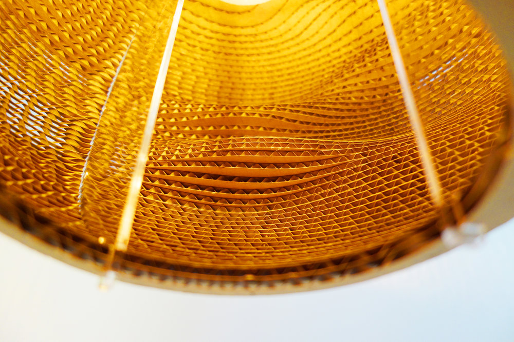 The lampshade has a special wavy pattern inside and the light shows how deep each layer is. -